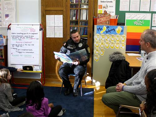 Police officer reading to class