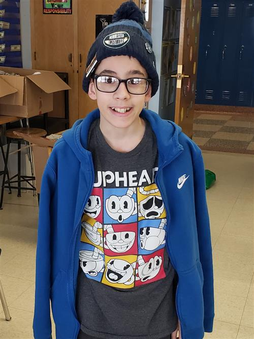 FMS student wearing new hat