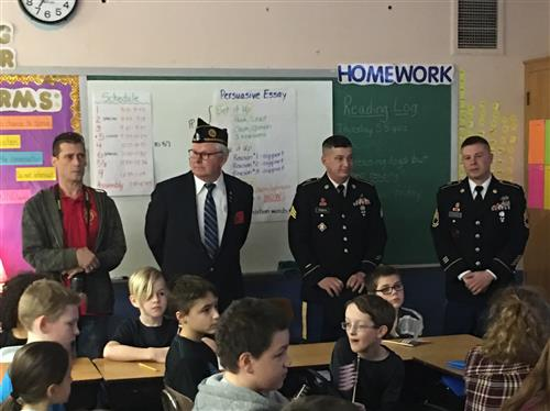 American Legion representatives in classroom