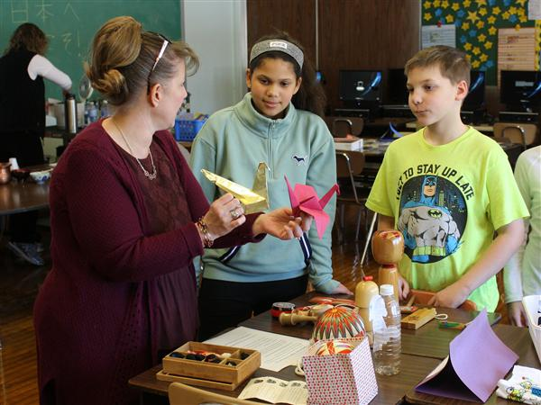 Hoover Middle students examine paper cranes