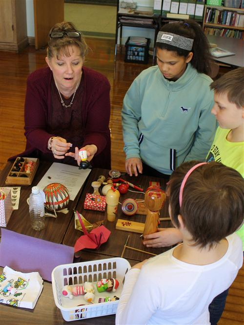 Hoover Middle students examine traditional Japanese toys