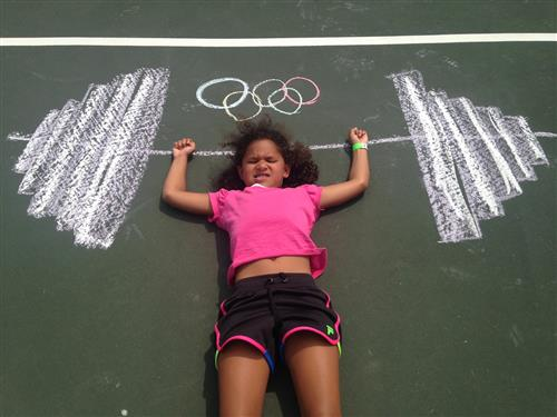 Girl with chalk drawing of barbell
