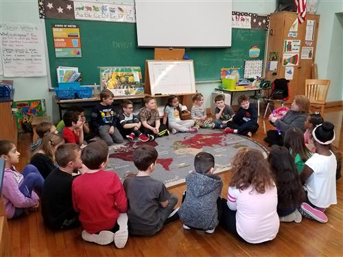 Students listen to story