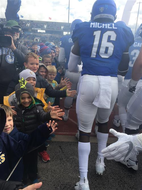 Students give players high-fives