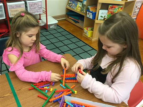 2 students playing with Playstix