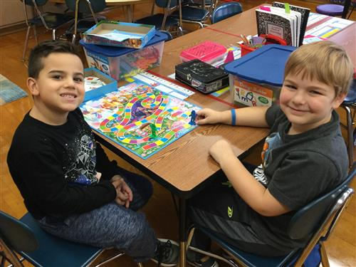 2 students playing Candy Land
