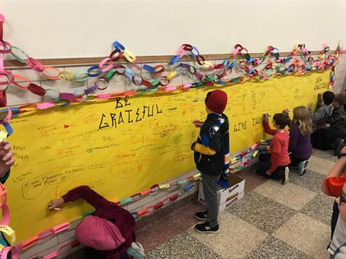 Franklin Elementary student writes on graffiti wall