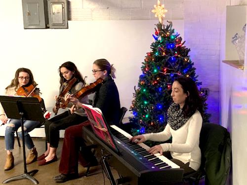 Kenmore East Orchestra students perform at the Vive Refugee Shelter