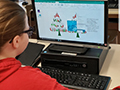 Students Practice Computer Skills While Spreading Holiday Joy